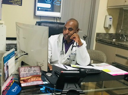 Sitting at a computer dictating notes as a medical student