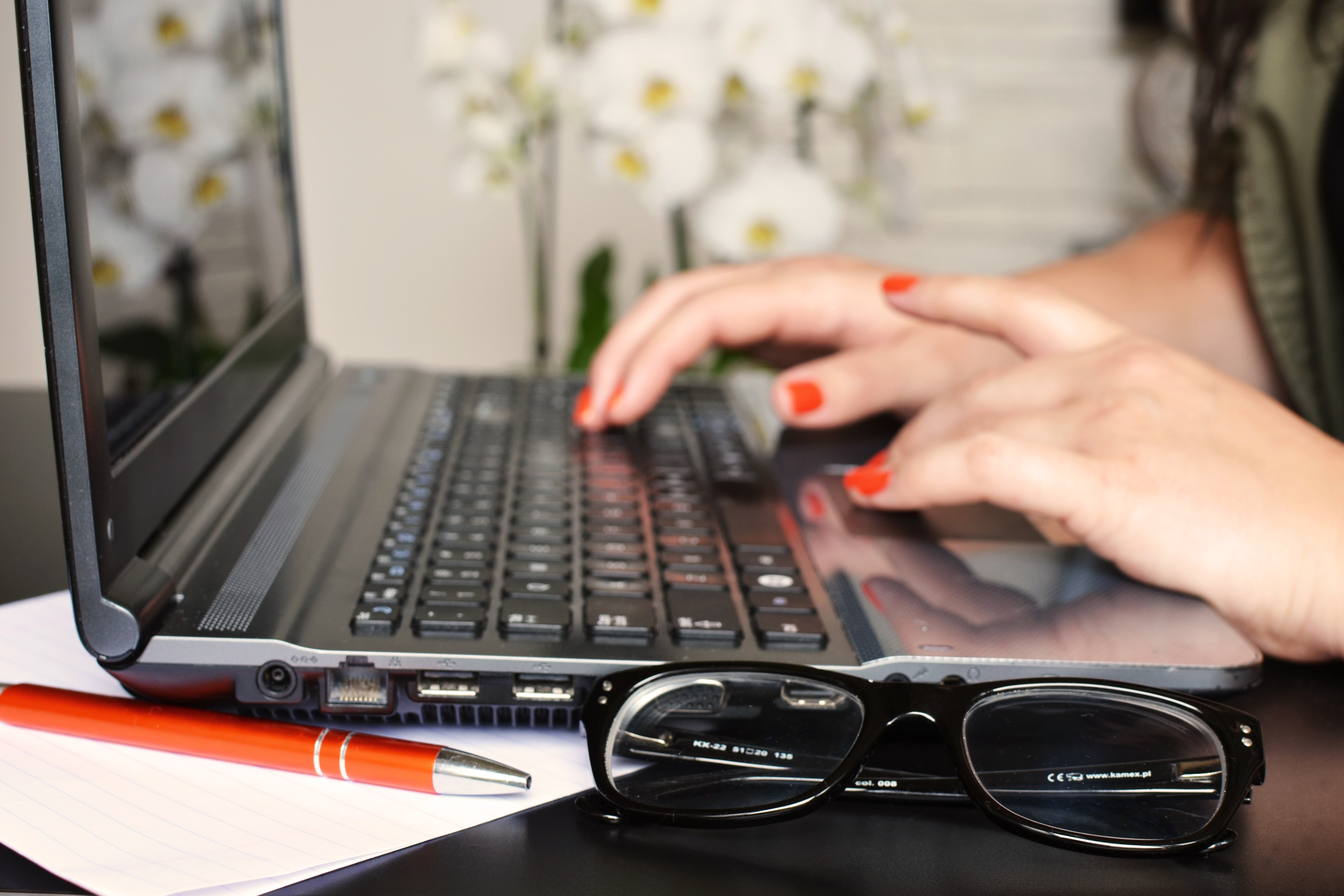 Woman typing medical school letter of recommendation